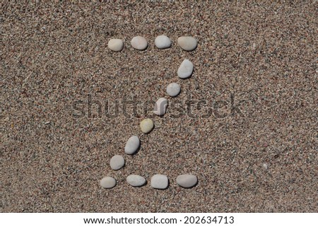 Z letter made of stones on sand  - stock photo