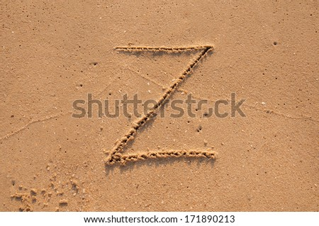 Z text written in the sandy on the beach - stock photo