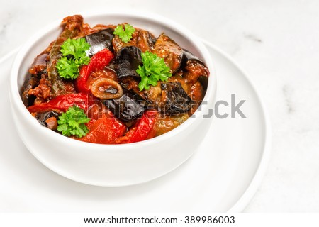 Zaalouk - Moroccan Eggplant Salad. traditional eggplant salad from morocco served on ceramic bowl. Bulgarian national dish made from roasted eggplant , garlic, peppers and spices. Vegetable caviar - stock photo