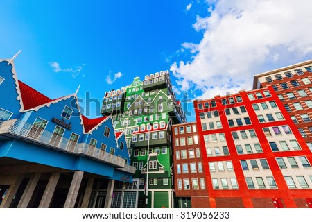 ZAANDAM, NETHERLANDS - SEPTEMBER 02, 2015: unique Inntel Hotel Zaandam.  The structure is a lively stacking of various examples of traditional houses found in the Zaan region - stock photo