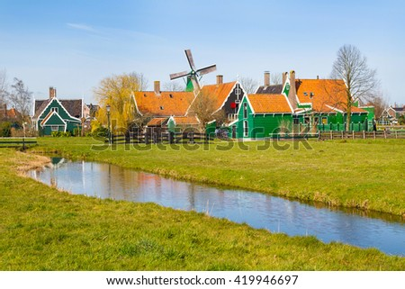 Zaanse Schans, Holland traditional village houses, windmill  against blue sky - stock photo