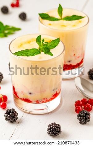 Zabaglione with strawberry jam and mint - stock photo