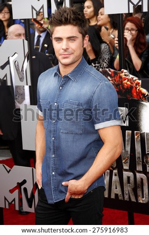 Zac Efron at the 2014 MTV Movie Awards held at the Nokia Theatre L.A. Live in Los Angeles on April 13, 2014 in Los Angeles, California.  - stock photo