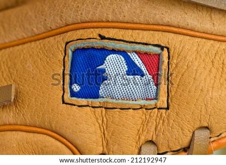 ZAGREB , CROATIA - AUGUST 19 , 2014 :  MLB logo on baseball leather glove close up , product shot - stock photo
