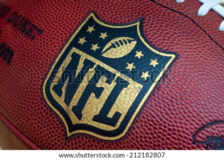 ZAGREB , CROATIA - AUGUST 21 , 2014 :  NFL logo printed on official NFL ball the Duke ,product shot - stock photo