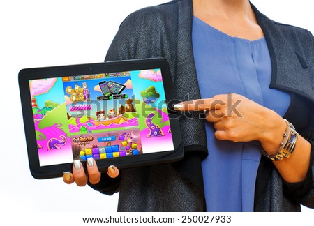 ZAGREB , CROATIA - 04 FEBRUARY 2015 - close up of Candy crush soda game application on android tablet PC in woman hands, product shot - stock photo