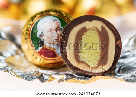 """ZAGREB, CROATIA - JANUARY 2, 2015: """"Mozartkugeln"""", typical Austrian sweets. Marzipan filled balls were created by Salzburg confectioner Paul Furst in 1890 and named after Wolfgang Amadeus Mozart. - stock photo"""