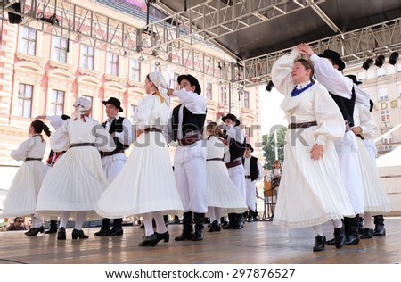 ZAGREB, CROATIA - JULY 19: Members of folk group Hrvatski narodni dom from Hamilton, Canada during the 49th International Folklore Festival in center of Zagreb, Croatia on July 19, 2015 - stock photo