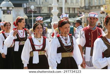 ZAGREB, CROATIA - JULY 18: Members of folk group Kumpanjija from Blato, island of Korcula, Croatia during the 49th International Folklore Festival in center of Zagreb, Croatia on July 18, 2015 - stock photo