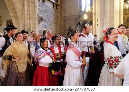 ZAGREB, CROATIA - JULY 19: Participants in the 49th International Folklore Festival at Sunday Mass in the Zagreb cathedral, Croatia on July 19, 2015 - stock photo