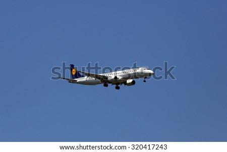 ZAGREB, CROATIA - JUNE 10: An Embraer ERJ-195, registration D-AEMA of Lufthansa CityLine landing at Zagreb Airport Pleso on June 10, 2015. - stock photo