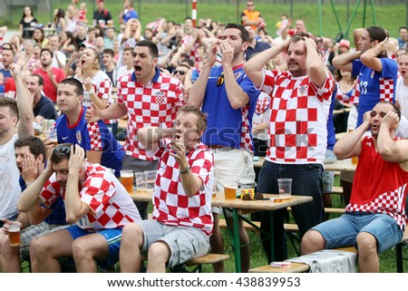 ZAGREB,CROATIA - JUNE 17,2016 : Croatian football fans on the playground at Jarun,watching EURO 2016 match Czech Republic vs Croatia in Zagreb,Croatia.Fans disappointed by missed shot of Croatia team. - stock photo