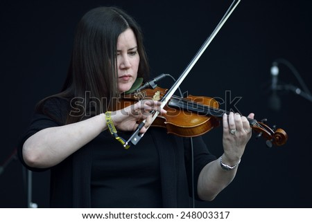 ZAGREB, CROATIA - 24 JUNE, 2014: Flogging Molly violinist Bridget Reagan performing at InMusic Festival. - stock photo