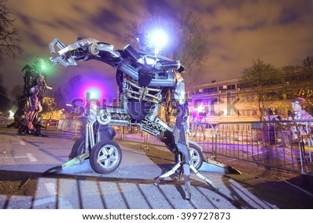 ZAGREB, CROATIA - MARCH 27, 2016 : People visiting exhibition at night by Danilo Baletic named Transformers protecting Zagreb in Zagreb,Croatia. Exhibition is made of automobile parts and waste. - stock photo