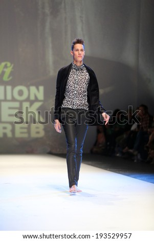 ZAGREB, CROATIA - MAY 09: Fashion model wearing clothes designed by Toni Rico on the Zagreb Fashion Week on May 09, 2014 in Zagreb, Croatia. - stock photo
