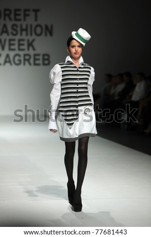 ZAGREB, CROATIA - MAY 19: Fashion model wears clothes made by Aba Tomicic in 'Fashion Week' show on May 19, 2011 in Zagreb, Croatia. - stock photo