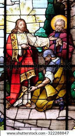 ZAGREB, CROATIA - MAY 28: Jesus and the centurion. Lord, I am not worthy to have you come under my roof..., stained glass in the Basilica of the Sacred Heart of Jesus in Zagreb, Croatia on May 28,2015 - stock photo