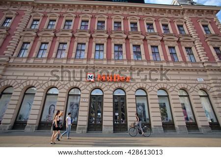 ZAGREB, CROATIA - MAY 26, 2016: Pedestrians walk past a M�¼ller Ltd. & Co. KG (Mueller) drug store.   - stock photo