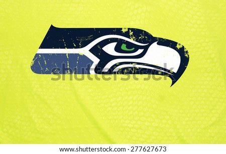 ZAGREB , CROATIA - May 12th , 2015 : NFL football club Seattle Seahawks logo grunge and thorned printed on poster  ,product shot - stock photo