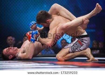 ZAGREB, CROATIA - NOVEMBER 2, 2013: Final fights at Croatian MMA legaue. Ivan VLADIMIR (blue gloves) VS Burhan AMETI (red gloves).  - stock photo