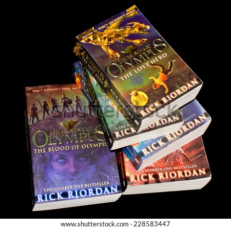 ZAGREB , CROATIA - NOVEMBER 6, 2014 : pile of books of Heroes of Olympus popular bestseller teen book series with Percy Jackson character by Rick Riordan ,product shot - stock photo