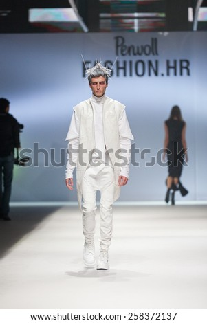 ZAGREB, CROATIA - OCTOBER 18, 2014: Fashion model wearing clothes designed by Coded Edge on the 'Fashion.hr' fashion show  - stock photo