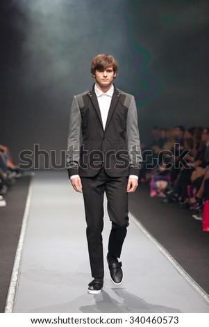 ZAGREB, CROATIA - OCTOBER 31, 2015: Fashion model wearing clothes designed by IK Studio on the 'Fashion.hr' fashion show - stock photo