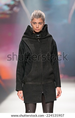 ZAGREB, CROATIA - OCTOBER 18, 2014: Fashion model wearing clothes designed by Marina Design on the 'Fashion.hr' fashion show  - stock photo