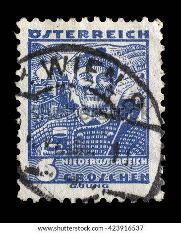 ZAGREB, CROATIA - SEPTEMBER 13: A stamp printed by AUSTRIA shows Man from Lower Austria (Niederosterreich), Traditional folk costume, circa 1934, on September 13, 2014, Zagreb, Croatia - stock photo
