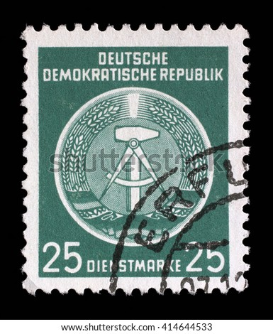 ZAGREB, CROATIA - SEPTEMBER 05: A Stamp printed in East Germany shows DDR national coat of arms with inscription Service Stamp, circa 1952, on September 05, 2014, Zagreb, Croatia - stock photo