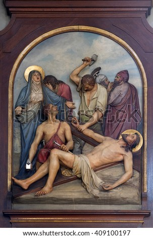 ZAGREB, CROATIA - SEPTEMBER 14: 11th Stations of the Cross, Crucifixion, Basilica of the Sacred Heart of Jesus in Zagreb, Croatia on September 14, 2015 - stock photo