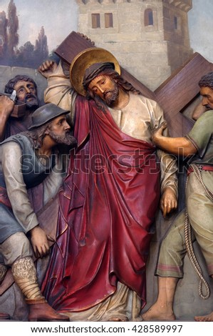 ZAGREB, CROATIA - SEPTEMBER 14: 5th Stations of the Cross, Simon of Cyrene carries the cross, Basilica of the Sacred Heart of Jesus in Zagreb, Croatia on September 14, 2015 - stock photo