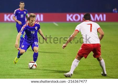 ZAGREB, CROATIA - SEPTEMBER 9, 2014: UEFA European Championship 2016 qualifiers in Group H - Croatia VS Malta. Luka MODRIC (10) and Clayton FAILLA (7). - stock photo