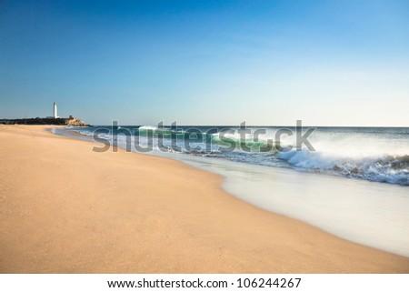 Zahora beach and the Trafalgar lighthouse. Cadiz, Andalusia - Spain. - stock photo