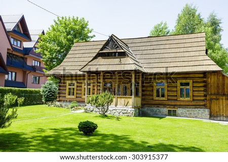 ZAKOPANE, POLAND - JUNE 13, 2015: The hut built of wood approx. 1907, listed in the municipal register of architectural heritage - stock photo