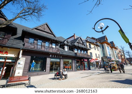 ZAKOPANE, POLAND - MARCH 09, 2015: Commercial premises located in wooden villa, built approx. 1910, at the main pedestrian street in the city named Krupowki - stock photo