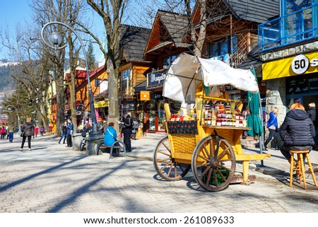 ZAKOPANE, POLAND - MARCH 09, 2015: Sales of Oscypek cheeses and other regional food products at  Krupowki street, since February 02, 2007 oscypek is Polish regional product protected by EU law  - stock photo