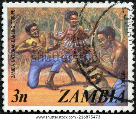 ZAMBIA - CIRCA 1980s: A stamp printed in the Zambia shows dancers of the national dance troupeA stamp , circa 1980s. - stock photo