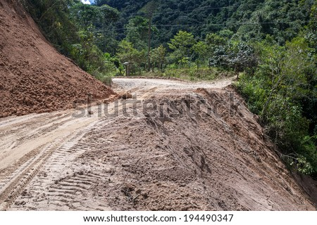 ZAMORA,ZAMORA CHINCHIPE ECUADOR, Circa May 2014. Landslide on mountain road in the Andes, Zamora, Zamora Chinchipe Circa May 2014. Rains have caused mudslide on roads in Andes Mountains of Ecuador - stock photo