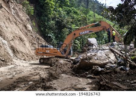 ZAMORA,ZAMORA CHINCHIPE ECUADOR, Circa May 2014. Landslide on mountain road road in the Andes, Zamora, Zamora Chinchipe Circa May 2014. Heavy rains have caused mudslide in the Andes Mountains Ecuador - stock photo