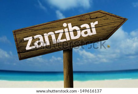 Zanzibar wooden sign with a beach on background - stock photo