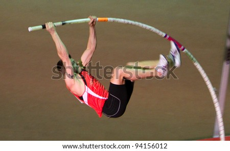 ZAPORIZHIA, UKRAINE - JAN.27: Denys Yurchenko on the Ukrainian Cup in Athletics, on January 27, 2012 in Zaporizhia, Ukraine. He won bronze medal in the pole vault event at Summer Olympics in Beijing. - stock photo