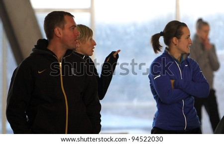 ZAPORIZHIA,UKRAINE - JAN 30:(L-R) Konstantin Rurak, Mariya Ryemyen, Olesya Povh - famous Ukrainian sprinters on Ukainian Junior Track and Field Championships on January 30, 2012 in Zaporizhia, Ukraine - stock photo