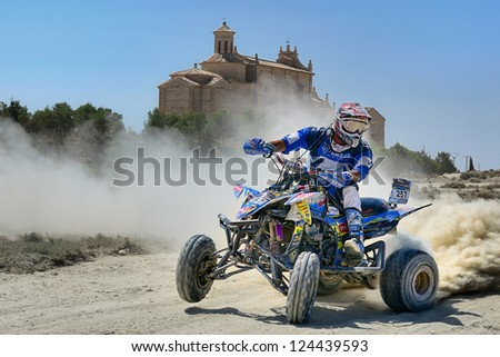 ZARAGOZA, SPAIN - JUL 21 : Beto Borrego and his Yamaha YFZ 450 R, races in Baja Spain, on Jul 21, 2012 in Zaragoza, Spain - stock photo