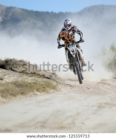 ZARAGOZA, SPAIN - JUL 23 : Spanish rider Joan Barreda races on his Husqvarna TE 511 during the Baja Spain, on Jul 23, 2011 in Zaragoza, Spain - stock photo