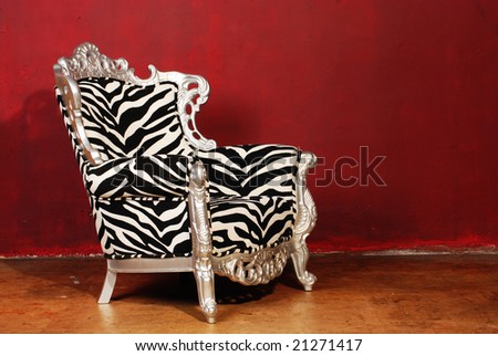 zebra chair isolated on red - stock photo
