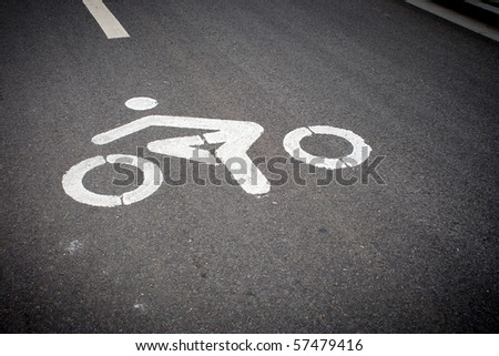Zebra crossing and bicycle sign on the street in china. - stock photo