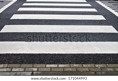 Zebra crossing on a speed bump horizontal - stock photo