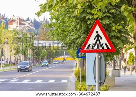 Zebra crossing, pedestrian cross warning traffic sign - stock photo
