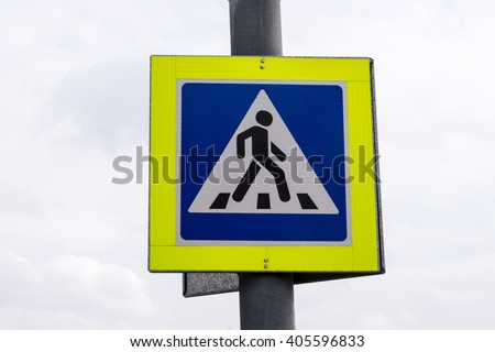 Zebra crossing, pedestrian cross warning traffic sign with bright yellow frame in Moscow, Russia - stock photo